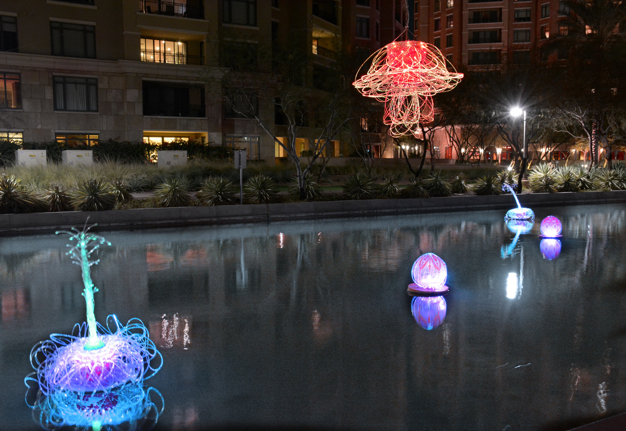 """Jellies in the Sky, Cacti in the Water"" - a glowing, fiber optic sculpture installed as a temporary exhibit in the Arizona Canal."