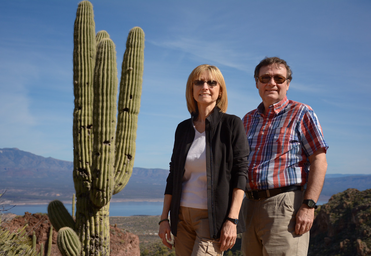 "As we descended from the Tonto cliff dwellings, Jeanne and I paused for a ""self portrait"" alongside, what else?, but an Arizona saguaro cactus."