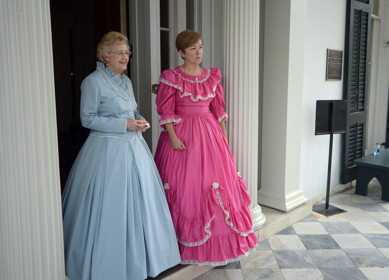 """A tradition of the Natchez """"Spring Pilgrimage"""" is to have local """"hostesses"""" attired in Civil War-era dresses provide tours of the homes."""