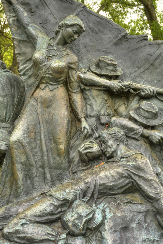 On the Alabama Memorial, the state is represented by a woman who gives aid to a wounded infantryman.