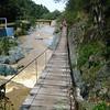 Suspension bridge over the water.