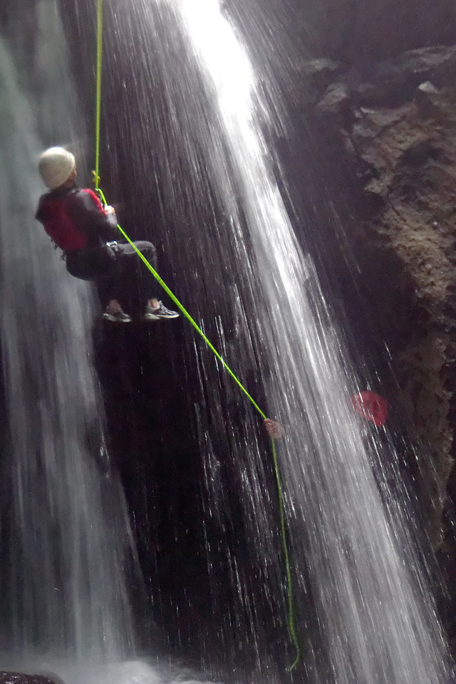 Marnie rappelling in canyon.