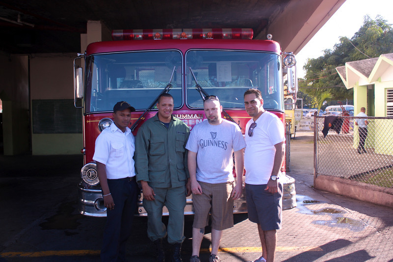 Jose and I with a Lt and Captain from the main fire station in Santiago, DR