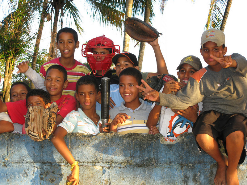 Local boys gather for a late-afternoon baseball game in Rio San Juan, a fishing village on the north coast of the Dominican Republic.
