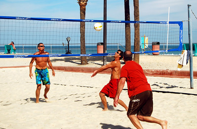 22 Guys playing Beach Volleyball