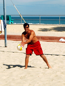 23 Guy playing Beach Volleyball