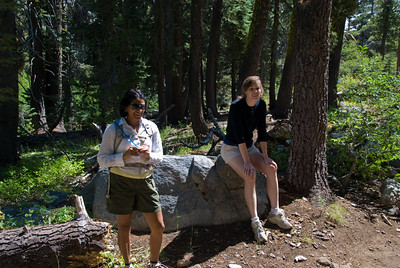 Bhumisha and Rachel look on as Mocha takes a drink.