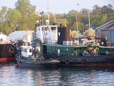 "A family of tugs make Sturgeon Bay's West Side dock their home. They are located between the Coast Guard Cutter ""Mobile Bay"" and the Michigan Street Bridge."