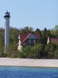 St. Martin Island, MI. This lighhouse was built in 1904 in response to the need for guidance through the passage between Escanaba and Lake Michigan. Ships had to make their way through the chain of islands that dotted the entrance to Green Bay between Door County and Michigan's Garden Peninsula.  The buildings were built of Cream City brick, and the tower is  hexagon in shape- never duplicated. It contained a fourth-order Fresnel lens. The island is privately owned, helping to preserve the buildings from vandalism. but they are deteriorating out of neglect.
