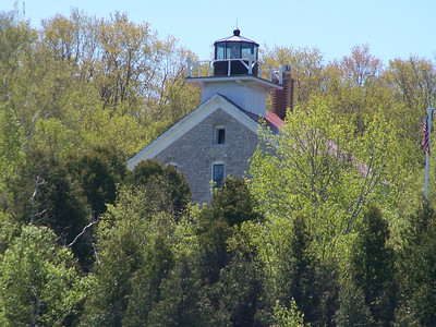 Pottawatomie Lighthouse on Rock Island is Door County's oldest lighthouse, completed in 1837 to guide vessels through the Rock Island passage and Port du Mort (Death's Door). It is accessible by a ferry ride from Washington Island, then a mile-long hike up the hill to the light's location on the bluff. It housed a fourth order Fresnel lens.