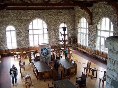 Interior of Viking Hall in the Rock Island boathouse, which housed Chester Thordarson's rare collection of books. Icelandic artist Halldor Einarson carved runic and block letters above the huge fireplace in Viking Hall, and on each of the 24 oak straight chairs he carved a scene from various Nordic myths, Names of principle characters were written in runic beneath each scene.  The book collection was sold to the University of Wisconsin- Madison, but you can still see the boathouse and furniture, which was donated back to the Park to keep them together