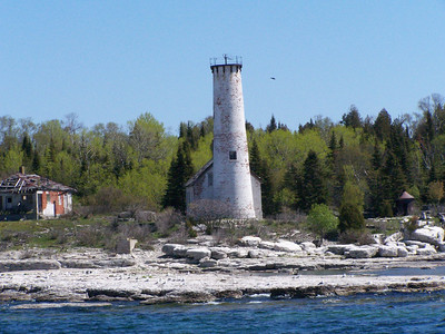 Poverty Island Lighthouse, built in 1858 off Michigan's Garden Peninsula, was designed  to duplicate the light built three years earlier in Sturgeon Bay.  It's  Fourth Order Fresnel lens helped to guide vessels through the island-dotted passage between Escanaba and Lake Michigan. The light was automated in 1957, and the condition of the island suits its name.