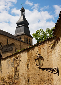 Sarlat Cathedral Tower poking out over the rooftops and lanterns that make this delightful town so special.