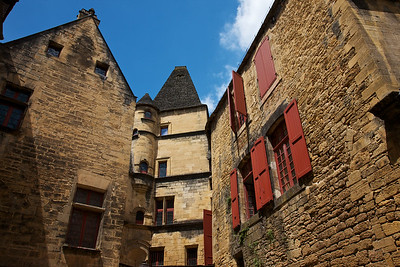 Sarlat Towers I loved this wonderful little village.  I haven't seen its' equal in beauty and charm.  Here the taller building show off the variety of architecture present.  I love all the different windows.