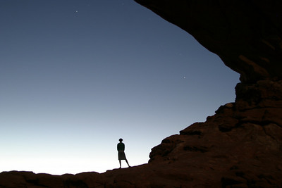 "Aekta welcomes dawn from the South Window of ""the Spectacles"" in Arches National Park."