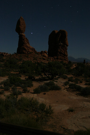 """Balanced Rock,"" one of Arches National Park's most famous residents, seen by predawn moonlight."