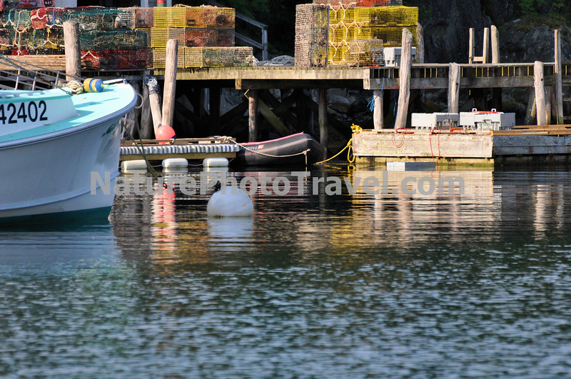 Stacked Lobster Pots & Boat. New Harbor, ME