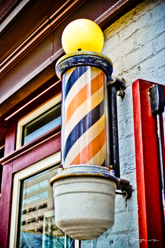 The traditional Barber Pole.  When lit - they're open.  I love seeing these time honored traditions in Raleigh, NC