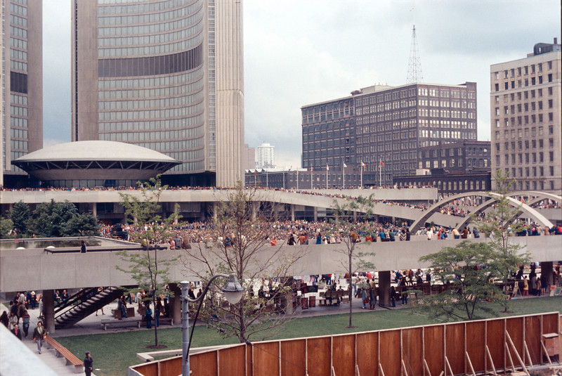 Nathan Philips Square in Toronto note Eaton's buildings to right of City Hall Aug 72