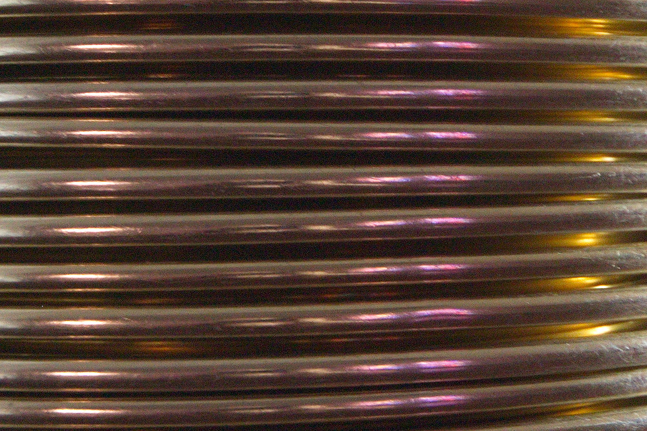 6368 What do you think this is? What could a church have that would look like the cooling coils of a still? Actually, this is a stack of collection plates. (24mm)