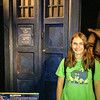 Lexie next to a Tardis.  Dr. Who Experience, Cardiff, Wales.  UK Vacation 2014-07-12