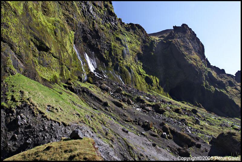 Waterfall out of the cliffs at the Bæjargil canyon at Hof