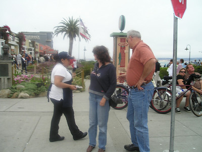 While they wait for their photographer fiend--er, friend--to catch up, this nice lady comes by and provides coupons for $$ off Ghirardelli sundaes! How sweet! Considering... guess where we're headed anyway...