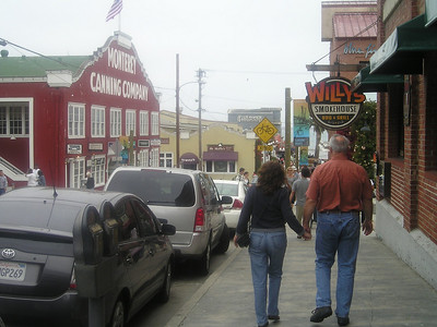 Sis and Bro-in-law strolling past the Monterey Canning Co building. No more canning goes on here, though.