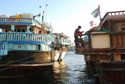 A bit of relaxation for a dhow's crew as they wait for the cargo to be loaded.