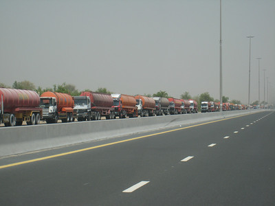 Dubai's infrastructure is struggling to deal with the rapidly increasing population.  The trucks in this queue, which stretches for kilometres, are all carrying raw sewerage and waiting to unload at the treatment plant behind International City.