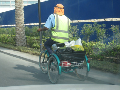 I had one of these trikes when I was a kid.  Darn, I want it back as some mornings this is the quickest way around the Burj Dubai area!  The rider is one of the Emaar Square rubbish men.  There's also a man who's full time job is to sweep dust off the speed humps.