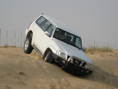 Someone's shortcut that went very wrong.  Taken on the road to Bab al Shams.
