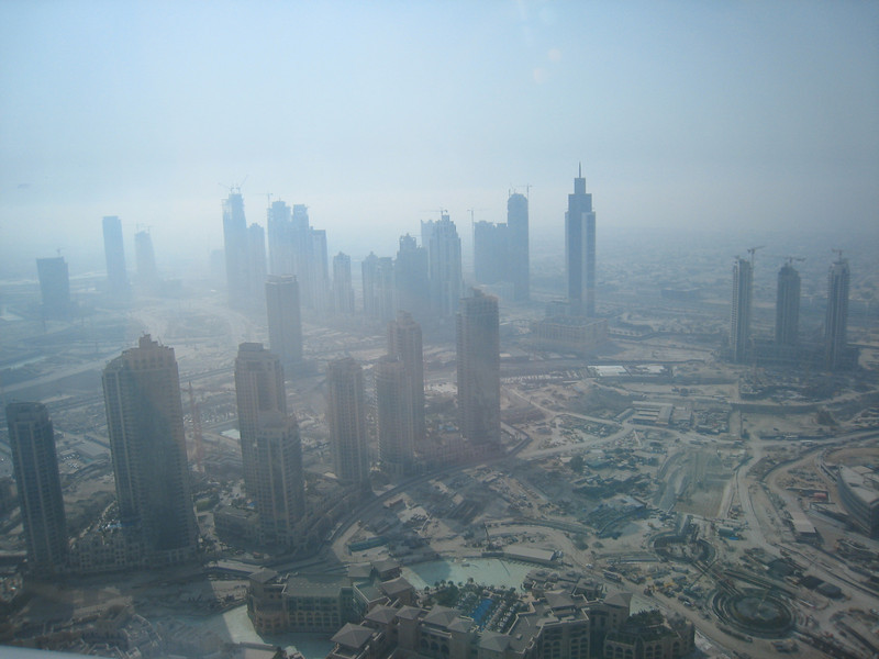 View over Dubai, the Palace Hotel in Old Town is at the bottom of the picture.  The cloud of smog/dust/whatever, is a regular feature of Dubai's skyline.