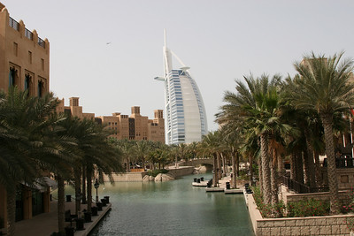 Madinat Jumeirah resort and Burg Al Arab hotel, Jumeirah Beach, Dubai.  Note the helicopter which has just taken off from the elevated helipad on Burg Al Arab.