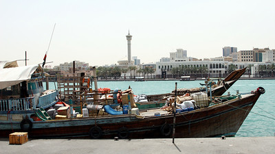 Dhows on Dubai Creek.  In the background is the Grand Mosque.