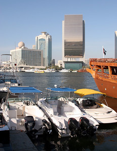 Dubai Creek.  The large glass fronted building in the background is the National Bank of Dubai.