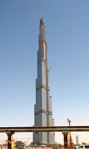 Burg Dubai Tower under construction.  This will be the worlds tallest structure and is due for completion in September 2009.  The final planned height is secret but will be at least 705m tall (160+ habitable floors).