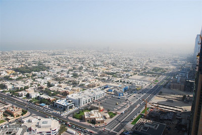 Looking north over Satwa. The building in the murk in the distance almost in the middle of the photo is Rydges Hotel in Satwa.  The road on the lower right runs parallel to SZR down the back of the Shangri-La, Fairmont, Park Place etc.