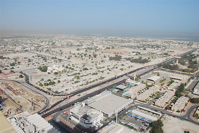 Overlooking the prison site and Al Wasl.  The French Bakery is in the white building in the foreground next to the car wash and petrol station.