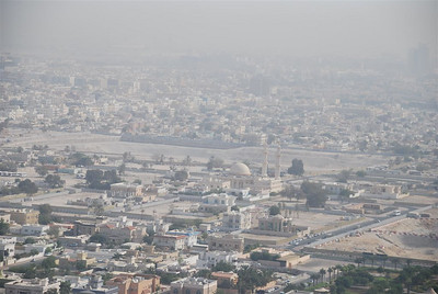"Looking towards Satwa, the empty area in the middle of the photo used to be houses.  The house were demolished to make way for the proposed Jumeirah Garden City project which is ""on hold"".  Its a typically hazy day in Dubai, the haze is a mixture of airborne construction site dust and sand."