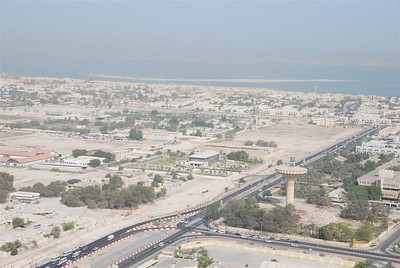 """Overlooking where the prison used to be towards Al Wasl Road and Jumeirah.  In the middle of the photo is the marketing suite for the postponed Meraas project, Jumeirah Garden City.  """"The World"""" on the horizon."""