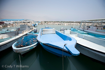 Blue boats are docked at a port in Oman, May 26, 2009. /© Cody Williams.