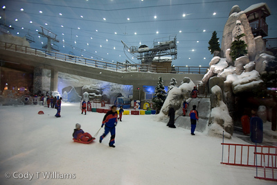 A child is pulled on a sled on the slopes of Dubai Ski, a full service indoor ski resort in the Mall of the Emirates, Dubai, United Arab Emirates (UAE), May 28, 2009. /© Cody Williams.