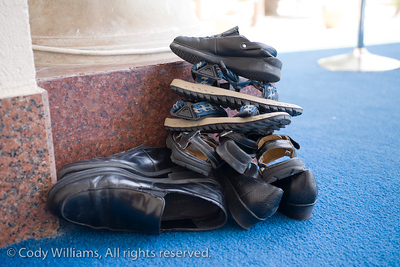 One families shoes are piled together outside the Jumeirah Mosque in Dubai, United Arab Emirates (UAE), May 27, 2009. /© Cody Williams.