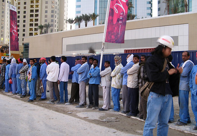 Construction workers from the sub-continent queueing up for buses after work outside the Jumeirah beach Residence, Dubai.