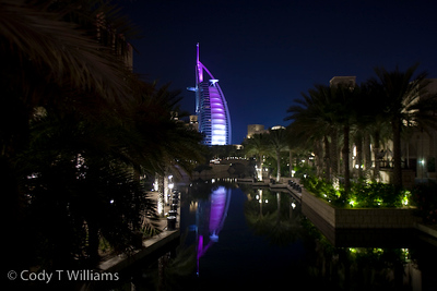 The lights of the Burj Al Arab luxury hotel glow purple at night in Dubai, United Arab Emirates (UAE), May 25, 2009. /© Cody Williams.