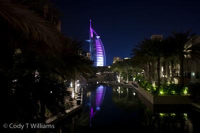 The lights of the Burj Al Arab luxury hotel glow purple at night in Dubai, United Arab Emirates (UAE), May 25, 2009. /© Cody Williams.