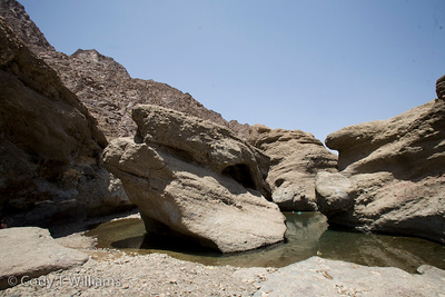 Rock formations dry out in a canyon of the Hajar Mountains near Hatta outside Dubai, United Arab Emirates (UAE), May 25, 2009. /© Cody Williams.