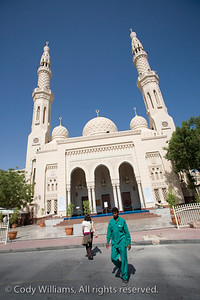 A man exits from the Jumeirah Mosque in Dubai, United Arab Emirates (UAE), May 27, 2009. /© Cody Williams.