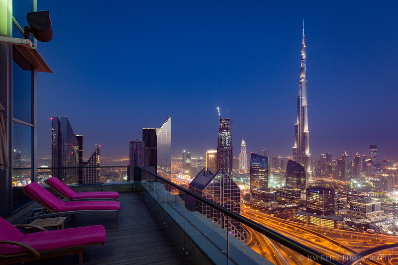 Hotel balcony evening view of the Burj Khalifa in Dubai, the world's tallest building.